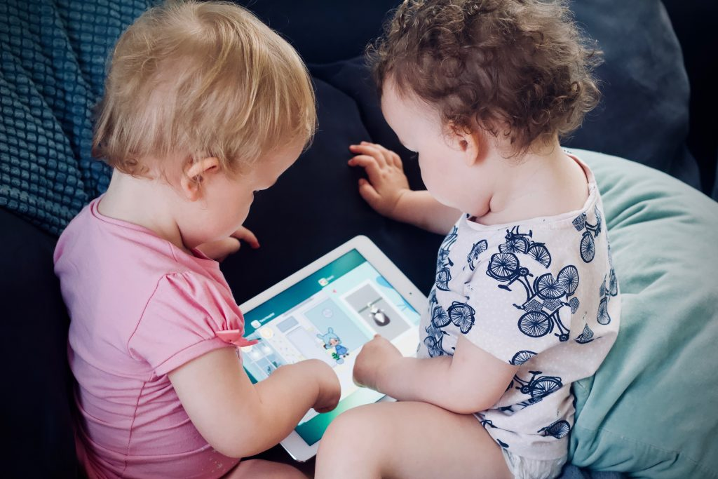 Children Playing with an iPad