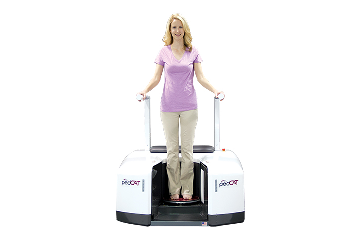 Woman inside a Standing CT Machine