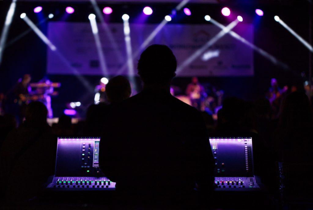 AV Operator Stands Behind Sound Console
