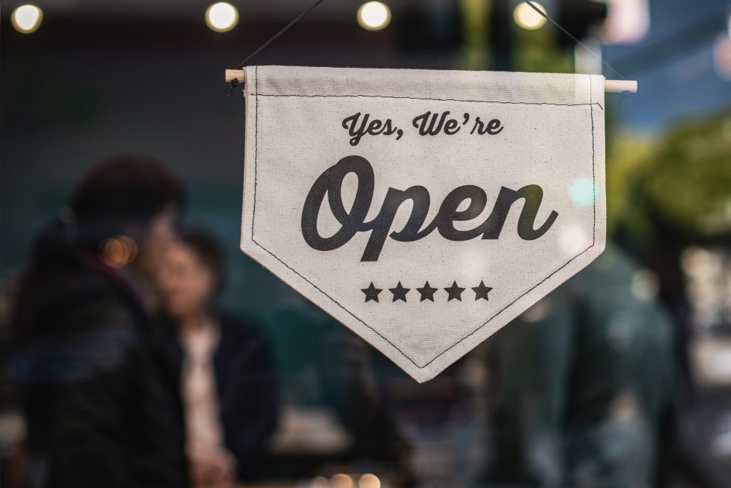 Open Sign in a Business Window